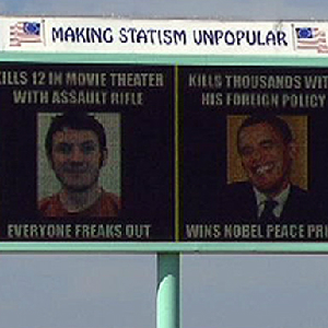 Libertarian Billboard Compares Obama To Batman Shooter