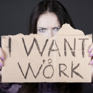 "Woman holding ""I want to work"" sign"