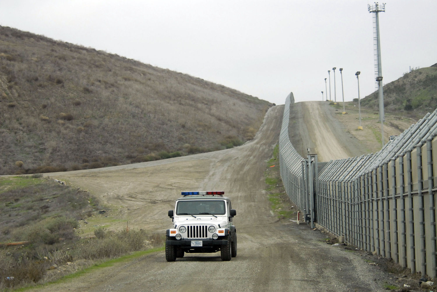A United States Border Patrol vehicle cruises along the primary and secondary fence line on the Tijuana, Mexico border in San Diego, December 20, 2007. The area has been the site of alleged increased violence against the Border Patrol. The Border Patrol says its agents were attacked nearly 1,000 times during a one-year period along the Mexican border, typically by assailants hurling rocks, bottles and bricks. Now the agency is responding with tear gas and powerful pepper-spray weapons firing into Mexico. (UPI Photo/Earl Cryer)