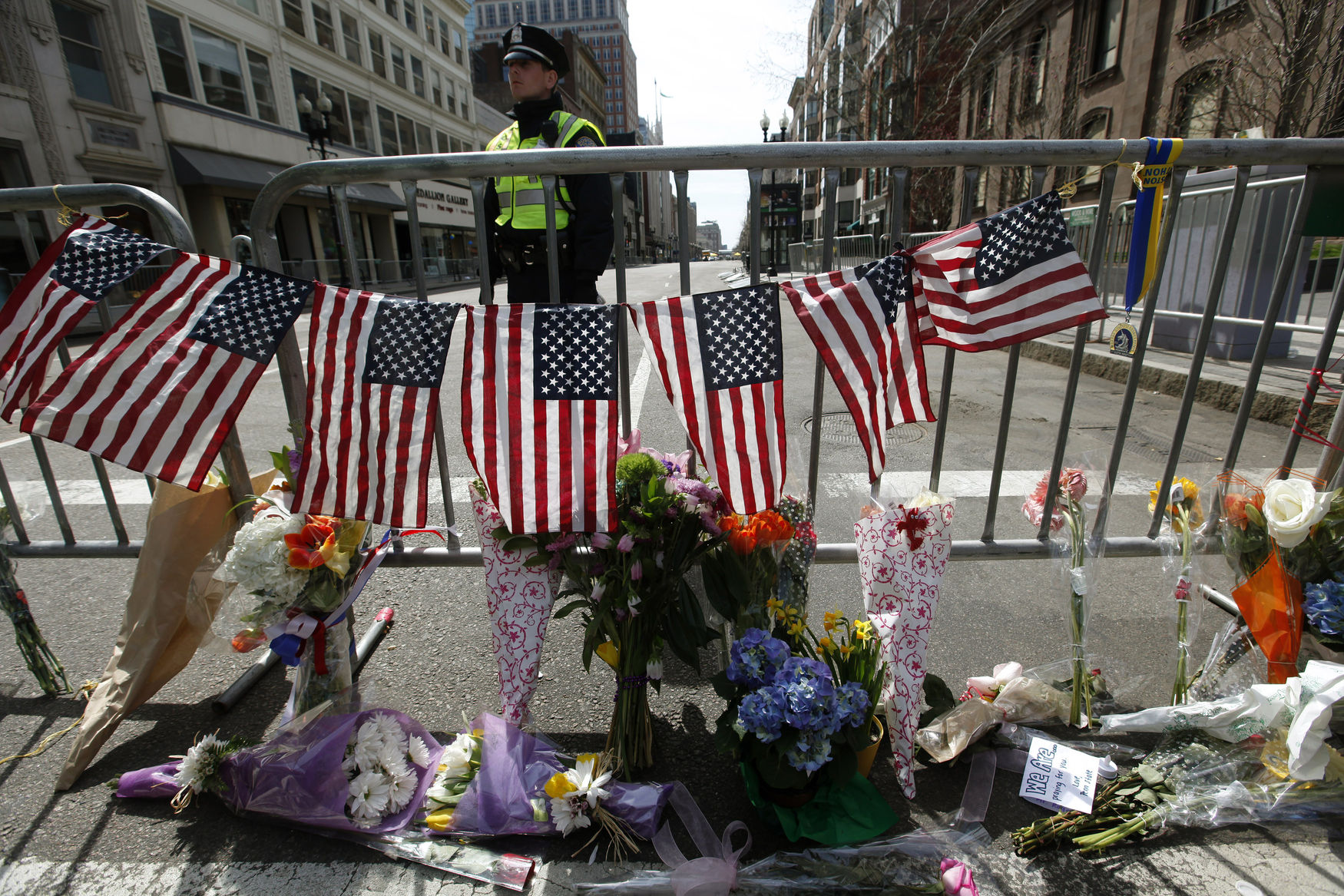 Boston Police officers stand guard at a makeshift memorial set up on Boylston Street in Boston, Massachusetts on April 16, 2013. Security is still high in the city after two bombs detonated on Boylston Street near the finish line of the Boston Marathon Monday afternoon killing 3 and injuring 150. UPI/Matthew Healey