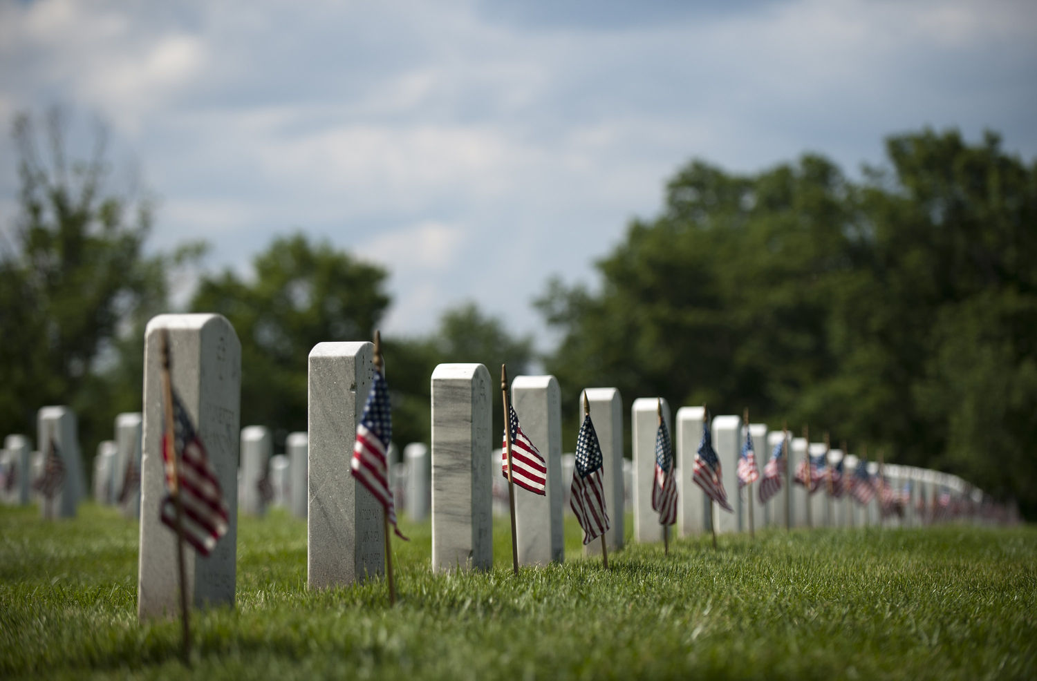 Members of the Army's Old Guard place flags at Arlington National Ceremtery