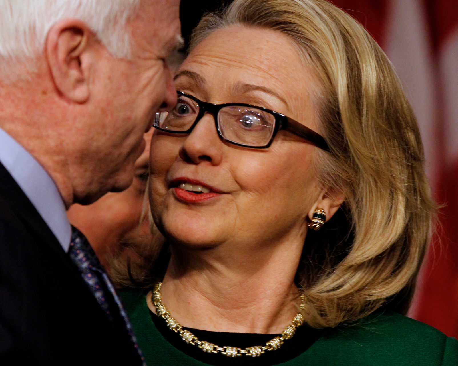 Secretary of State Hillary Clinton greets Senator John McCain (R-AZ) as she arrives to testify before the Senate Foreign Relations Committee hearing on the terrorist attacks on the U.S. Embassy in Benghazi, in Washington, DC on January 23, 2013. UPI/Molly Riley