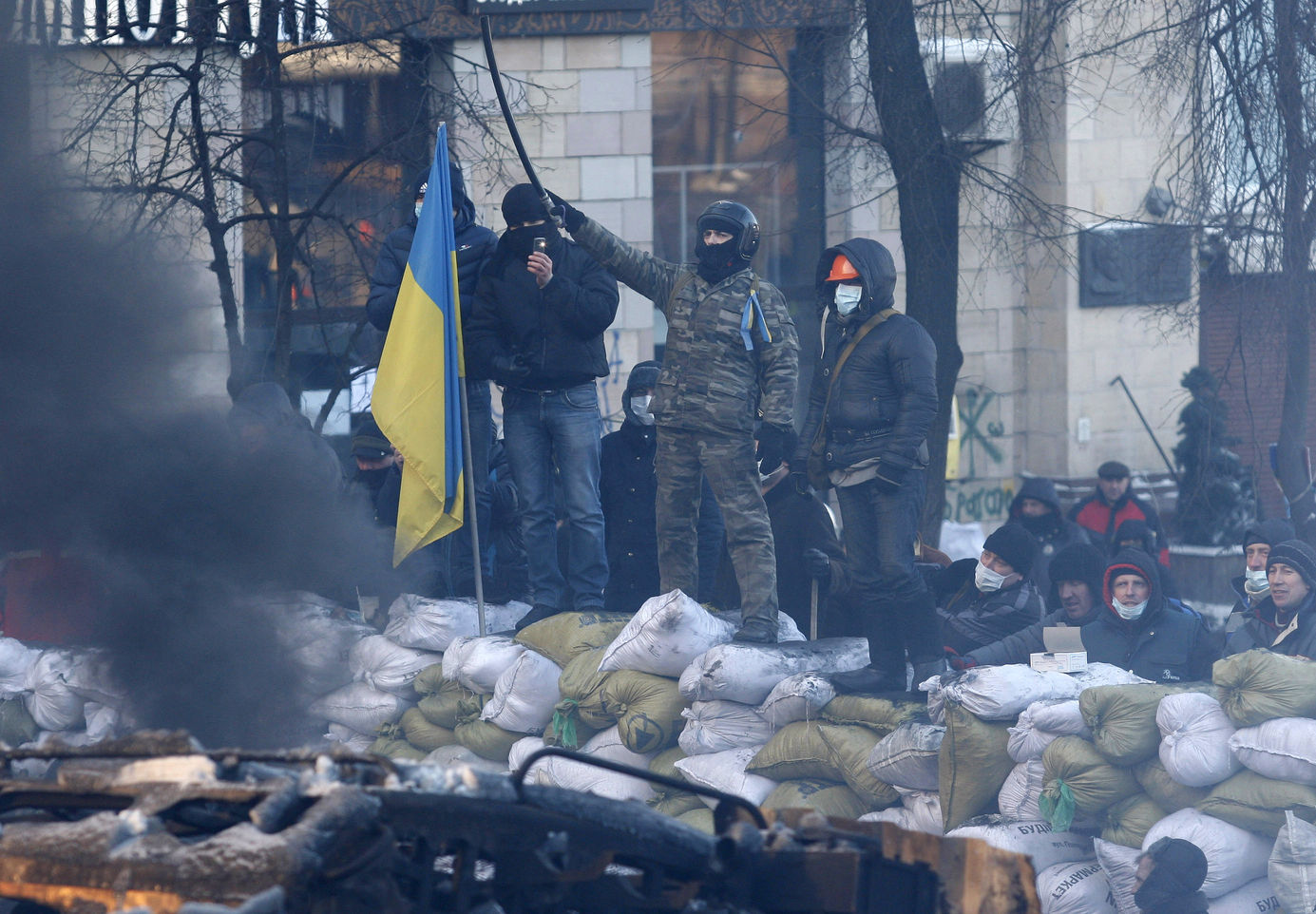 Ukrainian anti-government protesters stand on a barricade