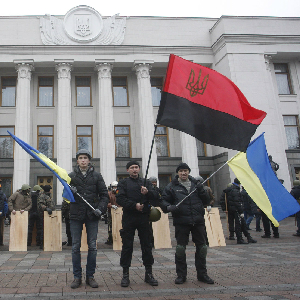 Anti-government protesters stand guard in front of the parliament building in Kiev on February 22