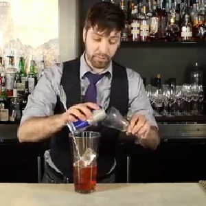 bartender mixing red bull cocktail