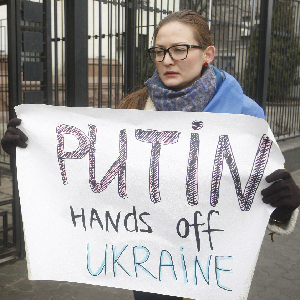 protester holding sign in ukraine