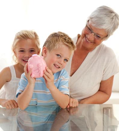Grandmother and children saving money