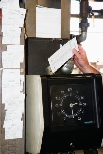 Employee Using Time Clock