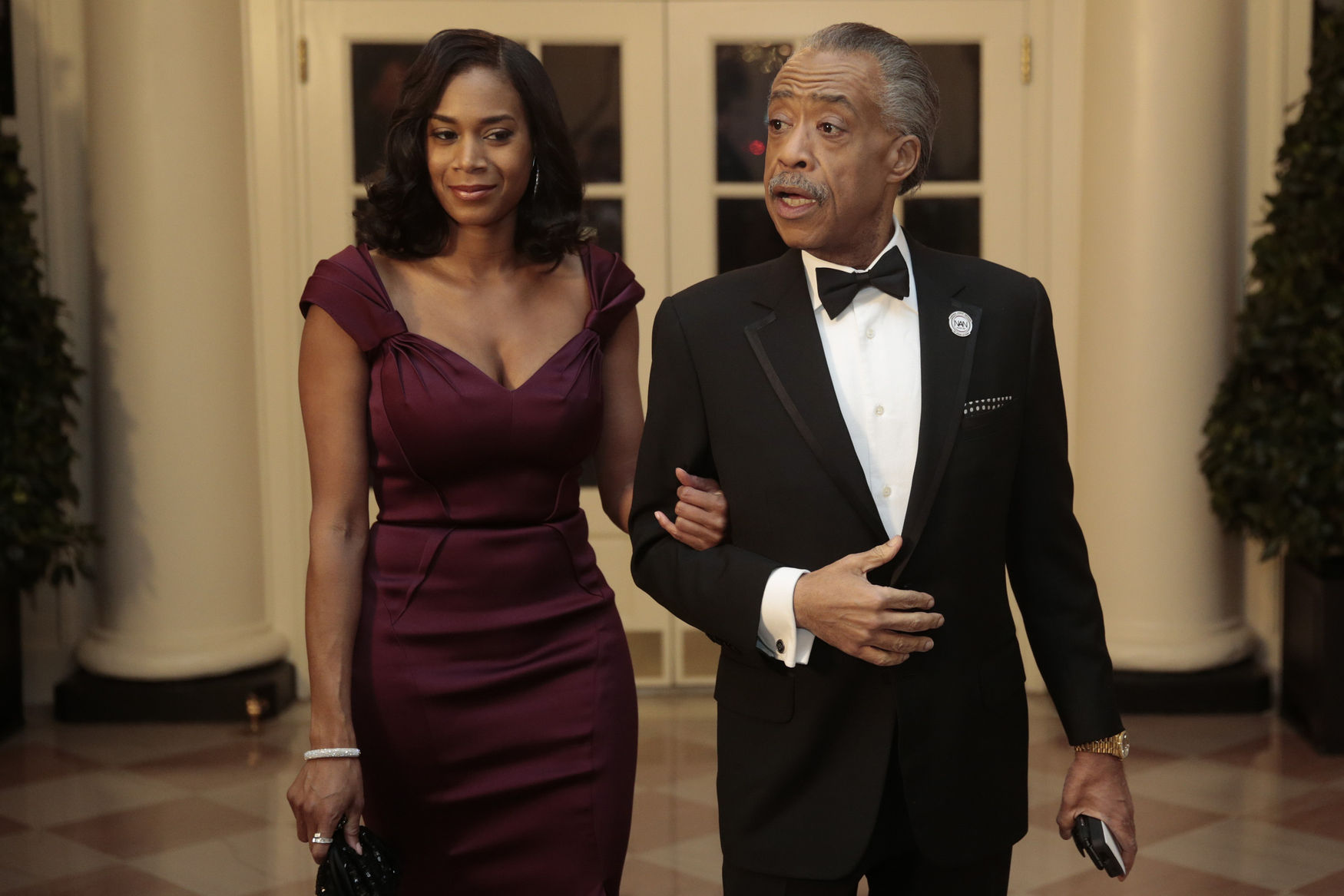 Reverend Al Sharpton, right, and Aisha I. McShaw arrive at a state dinner hosted by U.S. President Barack Obama and U.S. First Lady Michelle Obama in honor of French President Francois Hollande at the White House