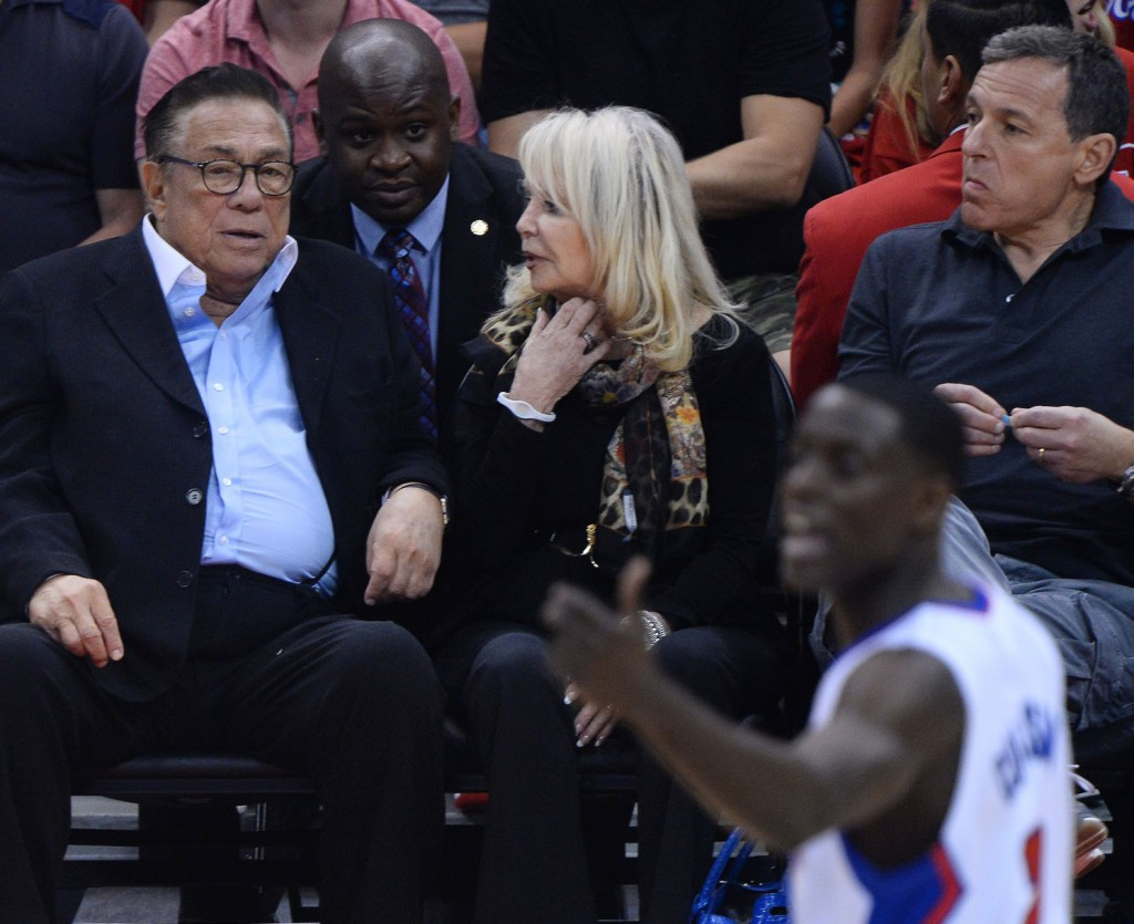 Los Angeles Clippers owner Donald Sterling sits court side with his wife, Rochelle Sterling