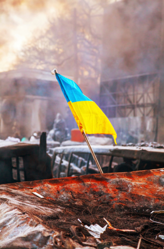 Ukrainian flag on the barricade at Hrushevskogo street in Kiev,