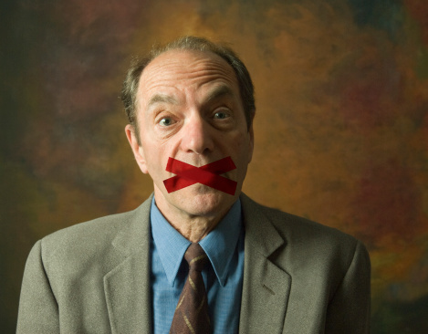 man with tape across mouth