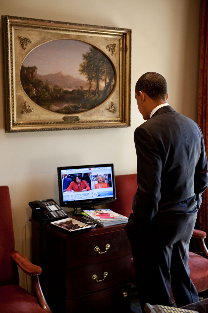 President Barack Obama watches the confirmation hearings for Judge Sonia Sotomayor in the outer Oval Office on July 14, 2009.