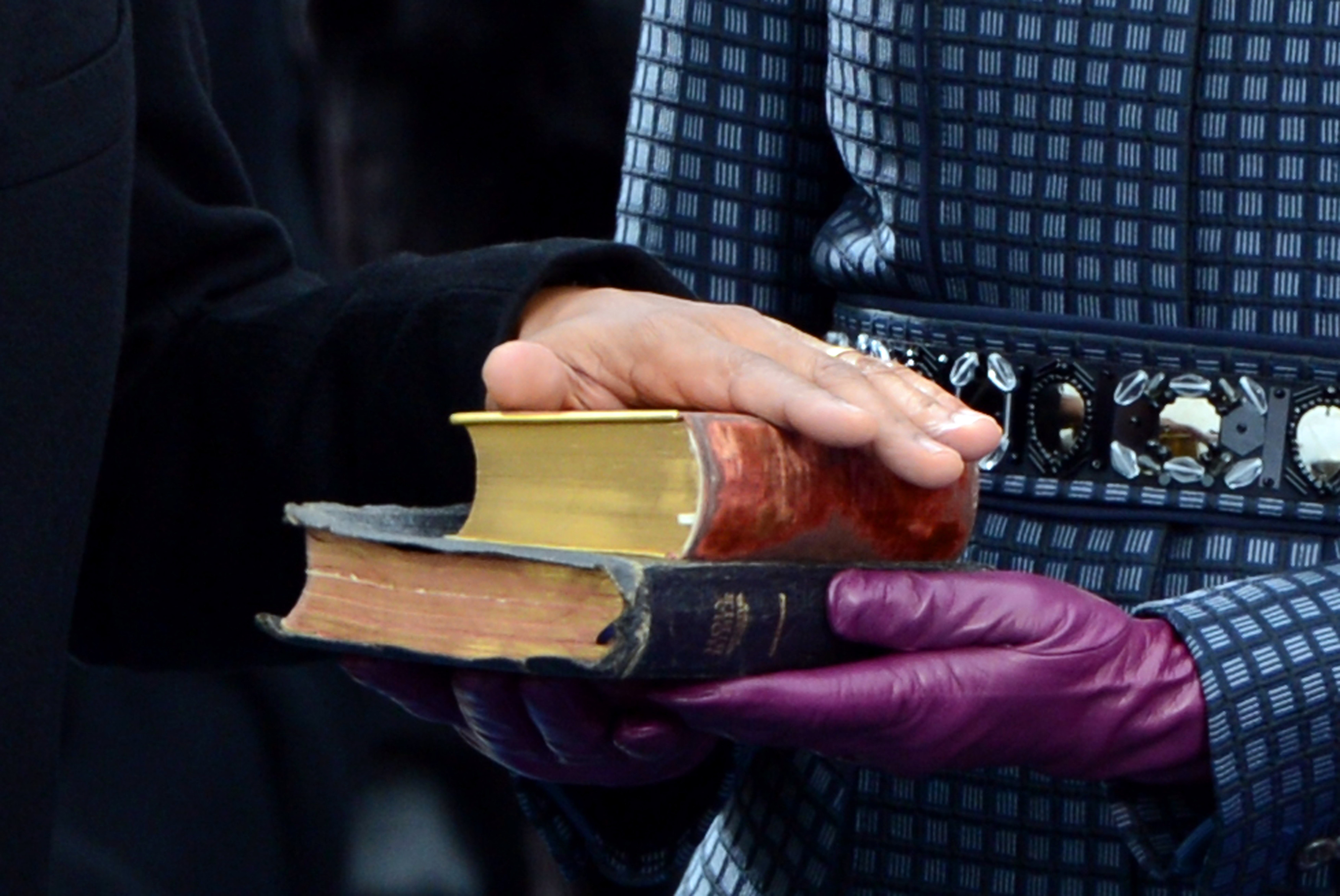 U.S. President Barack Obama puts his hand on the Bible held by First Lady Michelle Obama as he is sworn-in for a second term by Supreme Court Chief Justice John Roberts during his public inauguration ceremony at the U.S. Capitol Building in Washington, D.C. on January 21, 2013. President Obama was joined by First Lady Michelle Obama and daughters Sasha and Malia. UPI/Kevin Dietsch