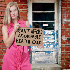 woman with obamacare sign