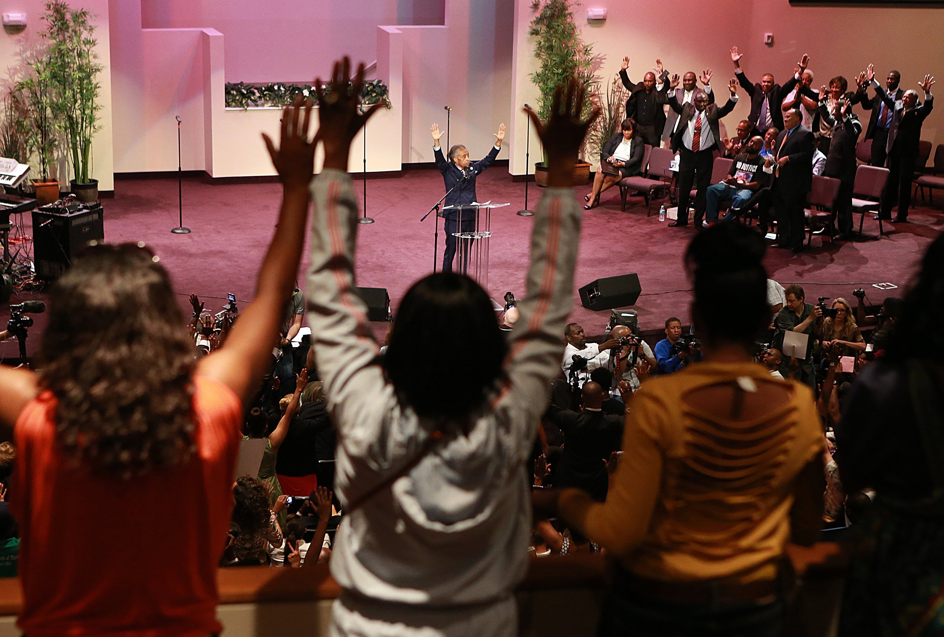 Rev. Al Sharpton speaks at Greater Grace Church in Ferguson, Mo., on Sunday Aug. 17, 2014, during a rally for justice for Michael Brown. (Christian Gooden/St. Louis Post-Dispatch/MCT)