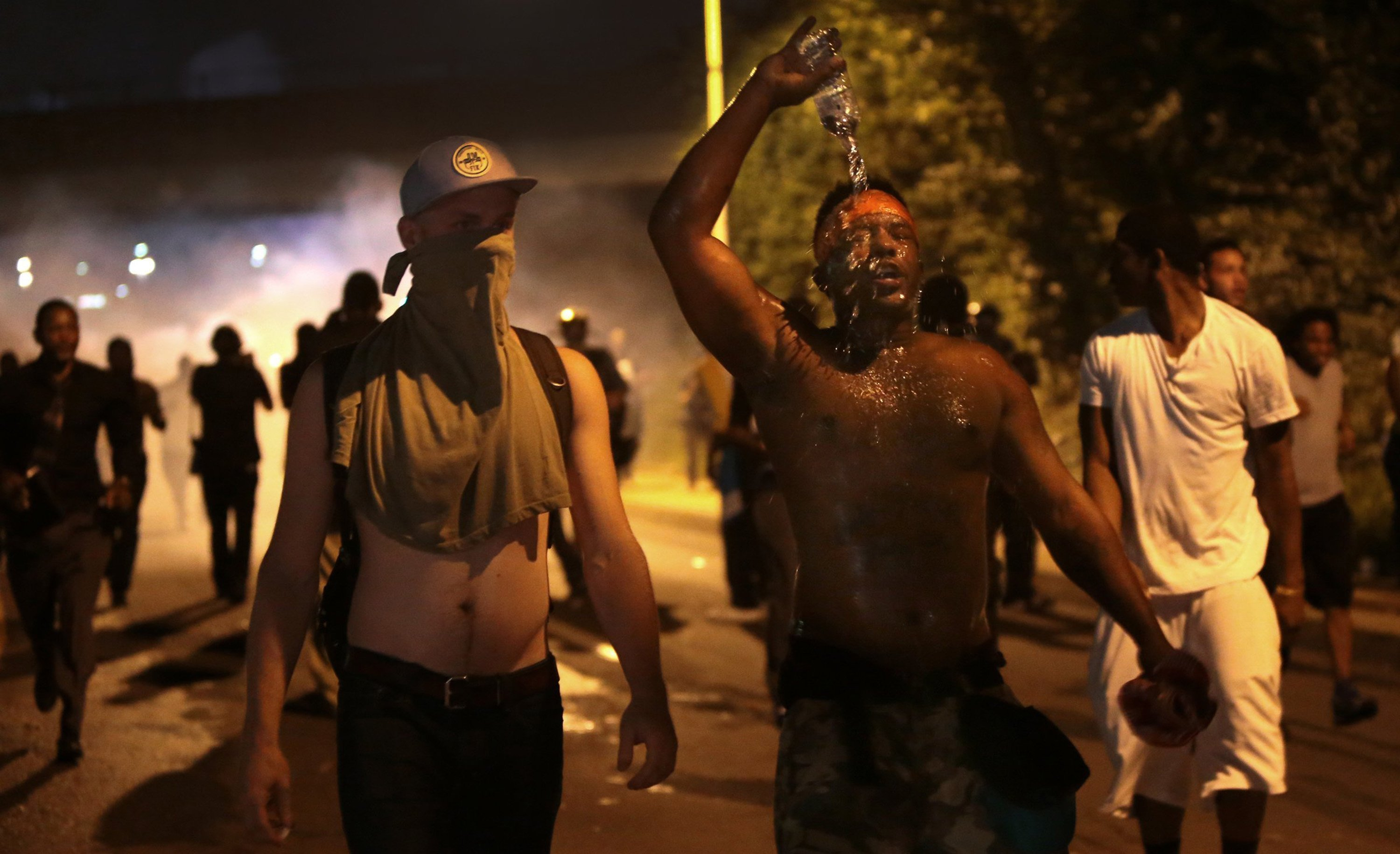 Protestors retreat from tear gas after marching toward the police command post on West Florissant Avenue on Sunday, Aug. 17, 2014 in Ferguson, Mo. (Robert Cohen/St. Louis Post-Dispatch/MCT)