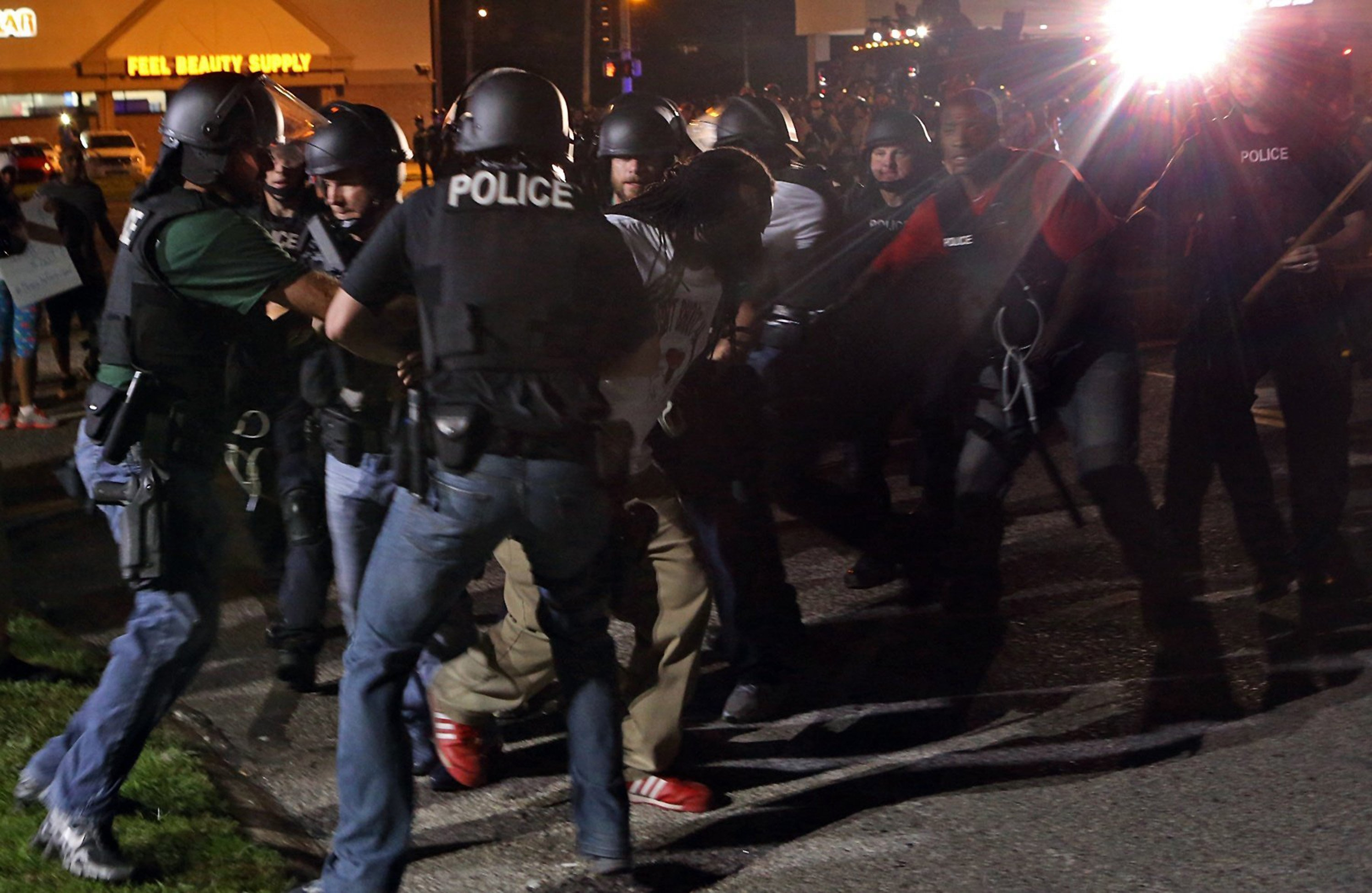 Police rushed a protester who was taunting and cursing them on W. Florissant in Ferguson, Mo. on Monday night, Aug. 18, 2014, next to the media area at Ferguson and W. Florissant. (J.B. Forbes/St. Louis Post-Dispatch/MCT)