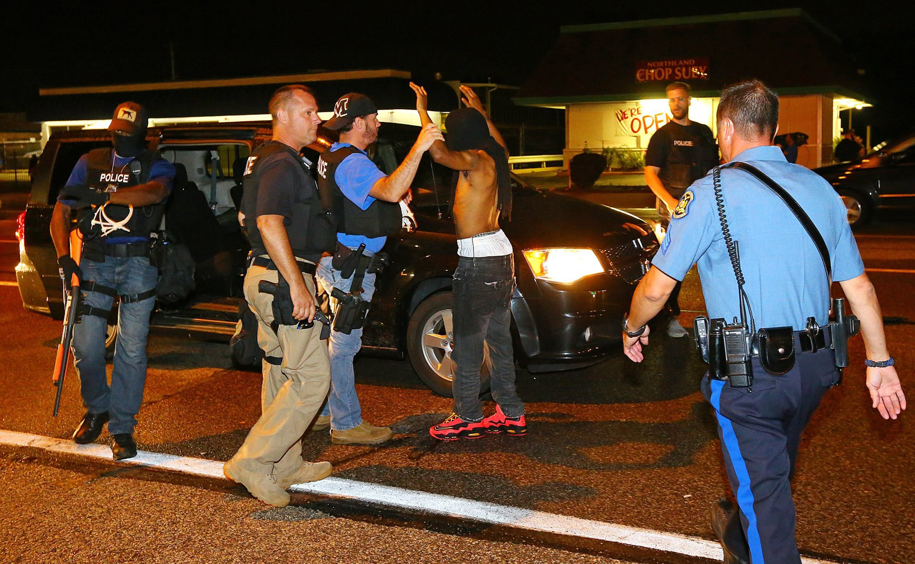 A protester is arrested while walking down the street on West Florissant Avenue on a relatively peaceful night on Wednesday, August 20, 2014, in Ferguson, Mo. (Curtis Compton/Atlanta Journal-Constitution/MCT)