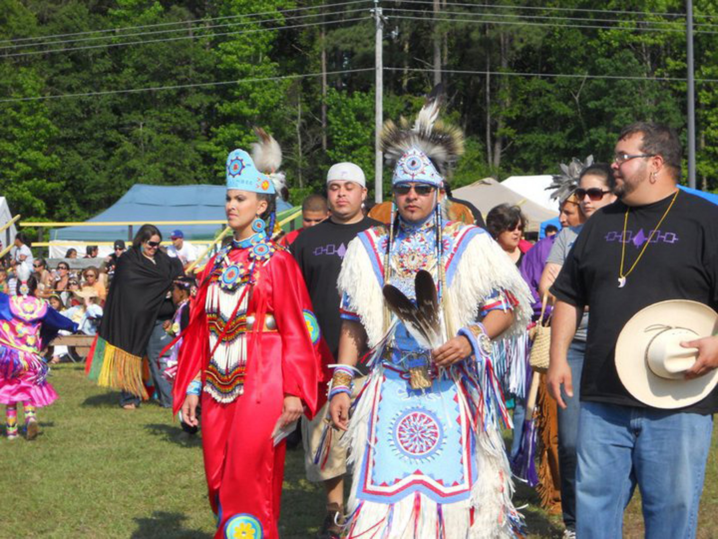 Rob Jacobs, center, a member of North Carolina's Lumbee Tribe, wore his eagle feathers at a Lumbee powwow. Since the tribe is not recognized by the federal government, Jacobs violates the Bald Eagle Protection Act whenever he wears his feathers. Only members of federally-recognized tribes are allowed to wear the feathers for religious or cultural purposes. (Photo courtesy of Rob Jacobs/MCT)