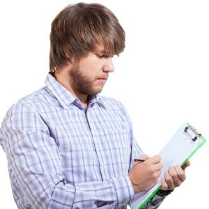 man writing checklist