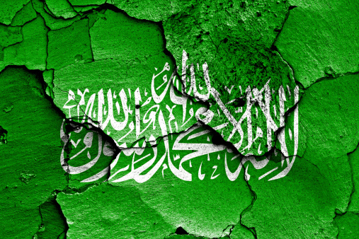 flag of Hamas painted on cracked wall