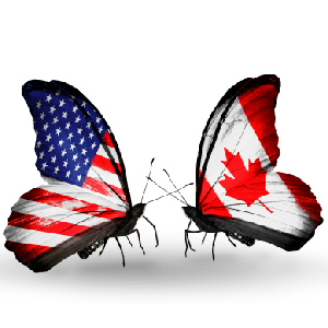 butterflies with canadian and u.s. flags for wings