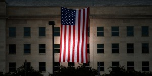 The Pentagon unveils a large American flag at sunrise on Thursday, Sept. 11, 2014, near the site where the building was struck on 9/11. (Olivier Douliery/Abaca Press/MCT)
