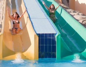 girls in swimming pool water slide