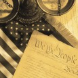 United States Constitution and scales of justice and flag