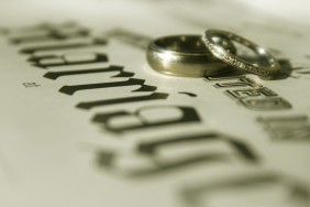 marriage certificate and wedding bands