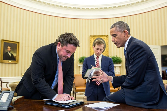 President Barack Obama works on his immigration speech with Director of Speechwriting Cody Keenan and Senior Presidential Speechwriter David Litt in the Oval Office.