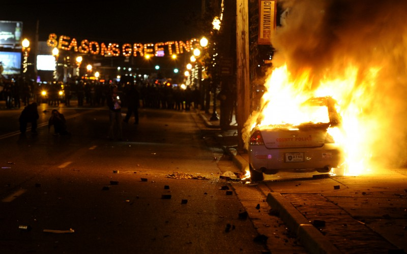 A St. Louis County police is set on fire along South Florissant Road in Ferguson following the announcement of the grand jury decision on Monday, Nov. 24, 2014. (Wally Skalij/Los Angeles Times/TNS)