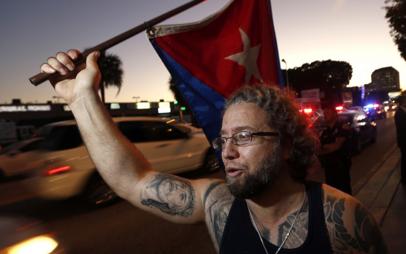 Abdel Rodriguez protests at Versaille's Restaurant in Miami on Wednesday, Dec. 17, 2014, after President Obama's decision to normalize relations between Cuba and the United States. (Al Diaz/Miami Herald/TNS)