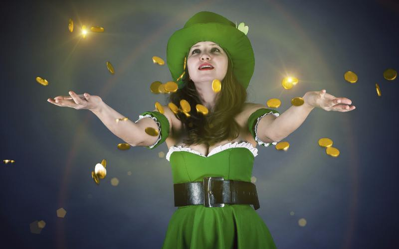 woman in leprechaun suit with gold coins