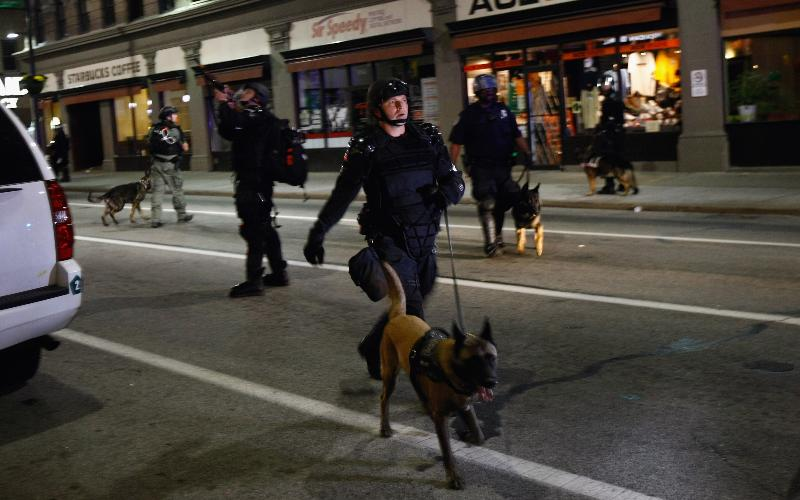 Police and police dogs on a Pittsburgh street in 2009.
