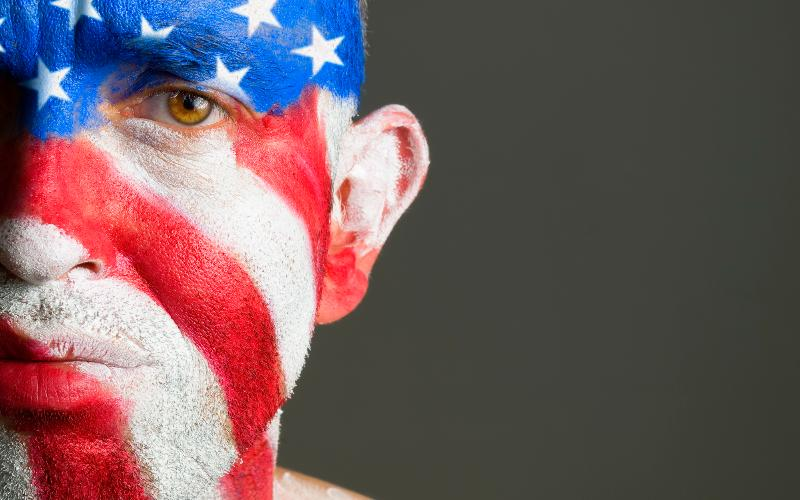 sad man with American flag face paint
