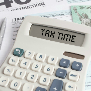 Tax Forms And Check With Calculator That Spells Out TAX TIME On The Display