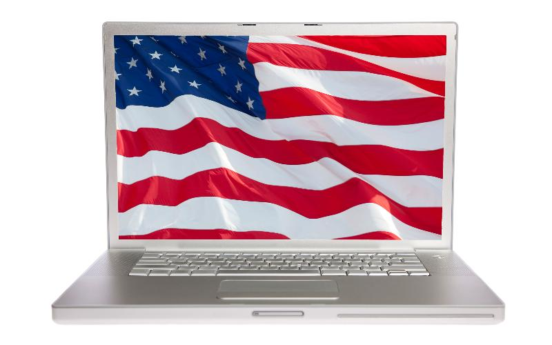 laptop with flag on screen