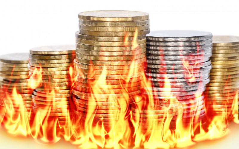 coins sitting in flames