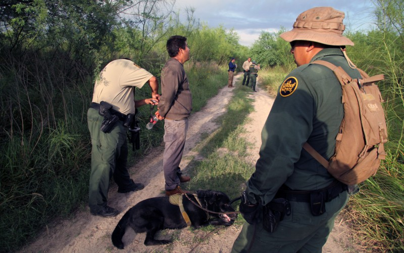 Illegal alien being detained by Border Patrol