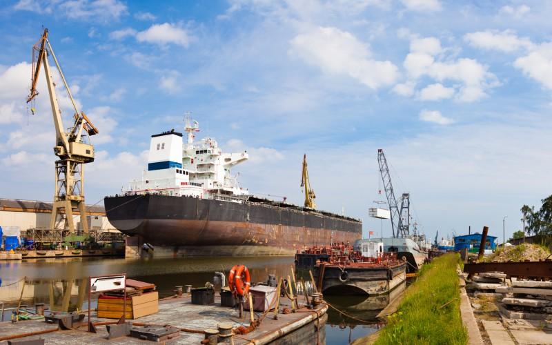 freight ship in drydock in bankrupt shipyard