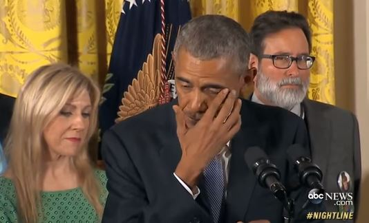 Obama wipes tear at news conference