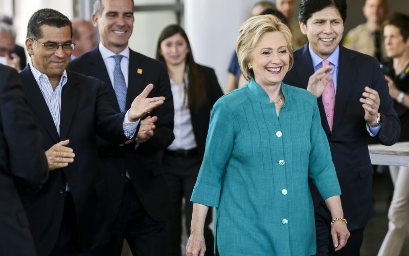 Democratic presidential candidate Hillary Clinton, center, with Rep. Xavier Becerra, left, Los Angeles mayor Eric Garcetti, and California's Senate President pro Tem Kevin de Leon, right, joins a conversation on immigration at the Culinary Arts Institute of Los Angeles Mission College on Saturday, June 4, 2016, in Sylmar, Calif. (Irfan Khan/Los Angeles Times/TNS)