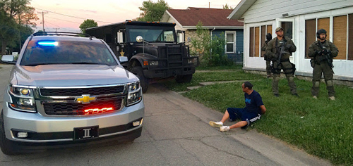 Man arrested sitting in grass